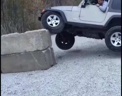 Driving Jeep on Concrete barricade