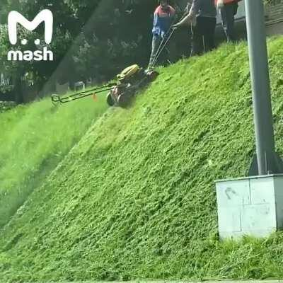 Mowing the lawn in Russia is an uphill battle.