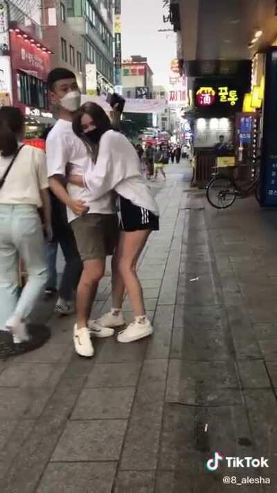 This girl makes tiktok videos of her forcibly hugging, touching or trapping Korean men. This is not okay behaviour. In all videos the men are visibly uncomfortable and try to get away from her, she either follows them or will not let go of them...if the r