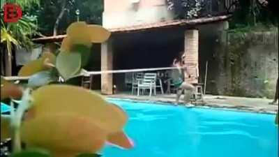 Playing with a tight-rope over a pool.