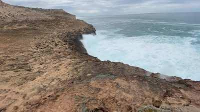 The sound of compressed air and venting sea spray hissing through the cliff face sounds like a dragons snarl.