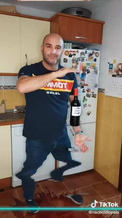 man wastes a bottle of wine