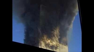 Different perspective of 2WTC collapsing on 9/11. Slow mo replay at the end.