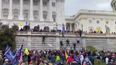 People are climbing the walls of the Capitol