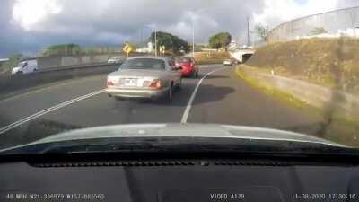 Ran off the road by a Jaguar GRF 937 in Honolulu. Report submitted to police.