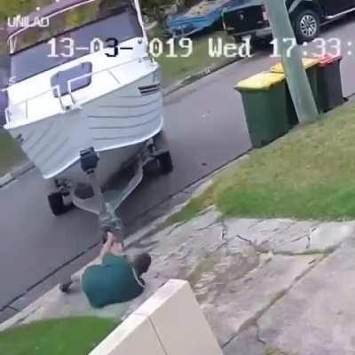 Man pulls his boat all the way to his truck