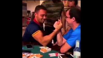 Trying to arm wrestle.