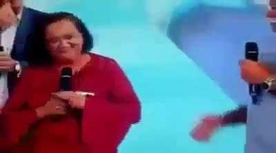 Woman's reaction when an Brazilian TV show fixed her car.