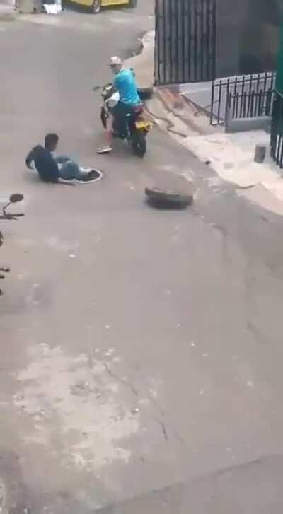 Instant Karma for stealing a manhole cover