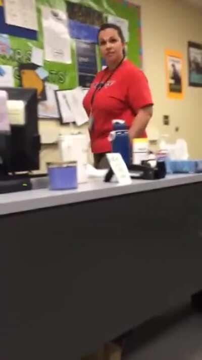 Student grabs teachers leg from under desk