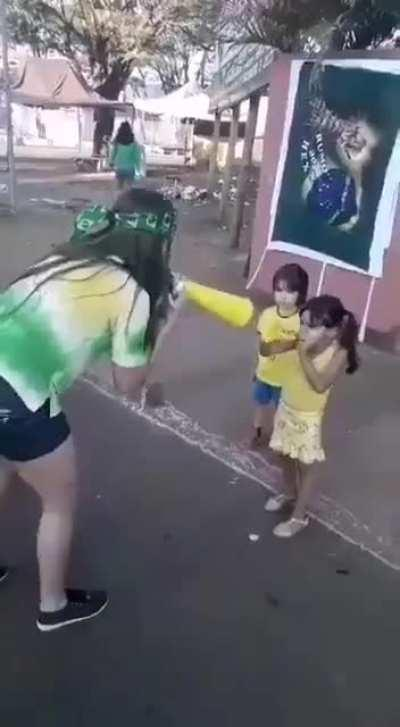 This little girl using the ultimate weapon to defeat her competitor.