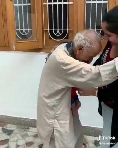 A grandpa meet his grandson for the first time