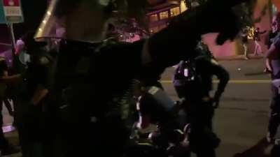 Another video from the protests in Portland, Or last night. It shows Portland police officers running after a civilian before tackling them and repeatedly punching them in the face while the man screams