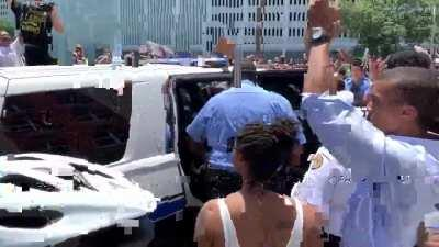 Video of woman at protest being let go by NOPD