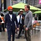Racist guy heckles and confronts a turban-wearing Sikh he mistook for a Muslim, who keeps remarkably cool as security guards lead the man away