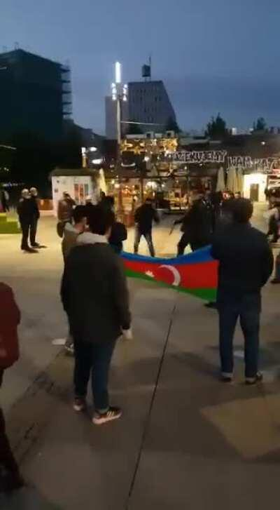 Armenian masked radicals with guns attacked the peaceful Azerbaijanis protesters in Katowice, Poland.