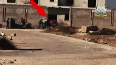 An SAA Soldier defends his building against a group of enemy fighters swarming his position