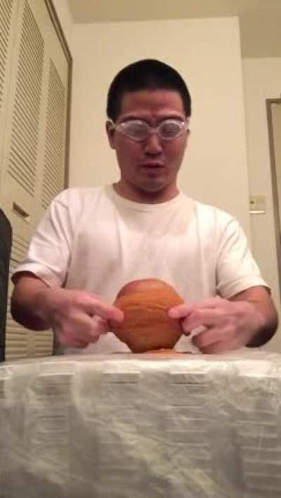 Putting rubber bands on an apple