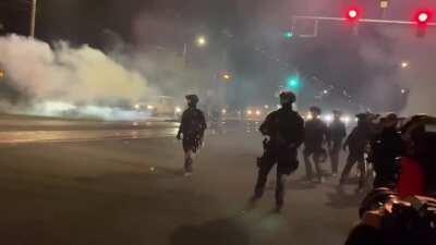 """Protest from east Portland, Or- on 9/7- after once again attacking the crowd police chase down people while heckling them. This police officer tells a protestor they're """"hiding behind the press like a coward"""""""
