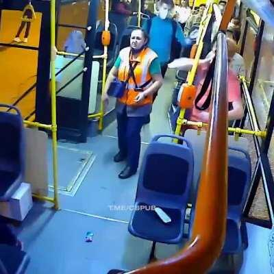 Fight on a Russian bus after one guy punches the female conductor