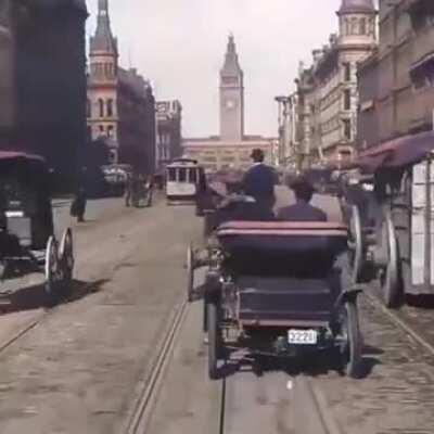 This hundred year old footage of a street car moving through a crowded city. San Fran prequake 1906