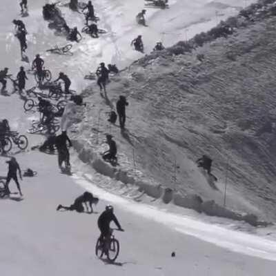 Riding hundreds of bicycles on a ski slope