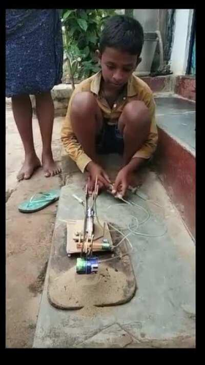 A young Indian kid builds his toy
