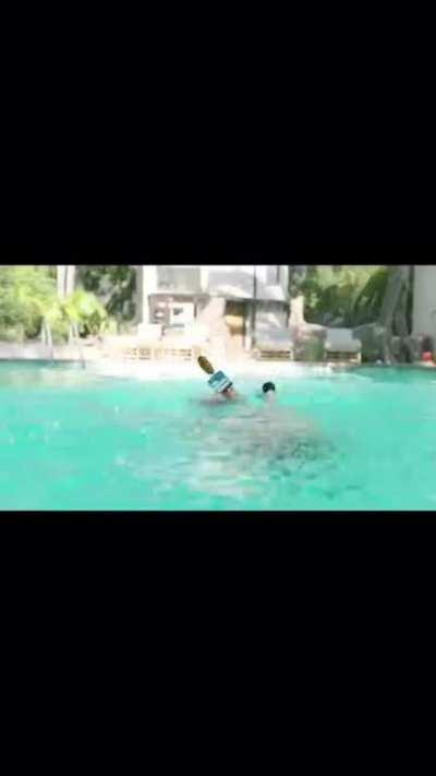 A pool snatching Lady Gaga's wig