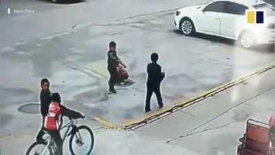 Boy throws Firecracker Into Manhole, causes explosion and making him fly.