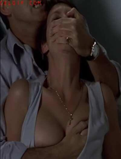 Jamie Lee Curtis getting her big tits groped by Pierce Brosnan in The Tailor of Panama.