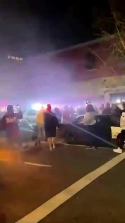 Police in Tacoma, Washington use an SUV to run over a crowd of pedestrians