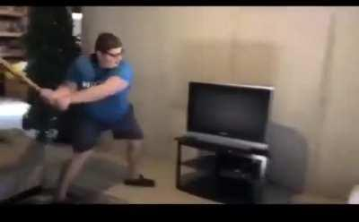 Wcgw with trying to break a TV with a bat