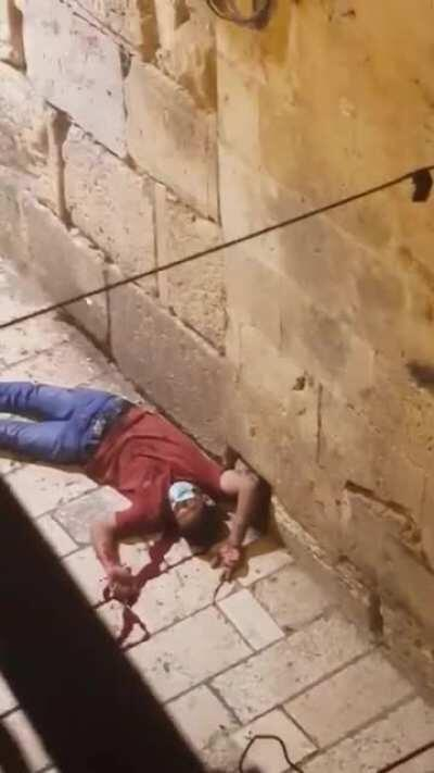 WATCH: isreali occupation soldiers executed a Palestinian young man in the occupied old city of Jerusalem and left him bleeding to die.