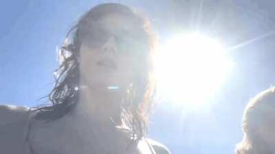 Alexandra Daddario bouncing on the beach