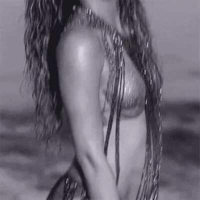 I love Shakira's naughty look as she bounces her fat ass
