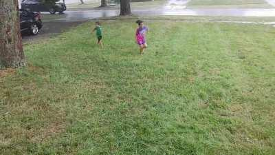 Kids enjoying playing in the rain after the recent heat wave