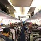 Passengers on Canadian airline calmly wait for their turn to exit the plane