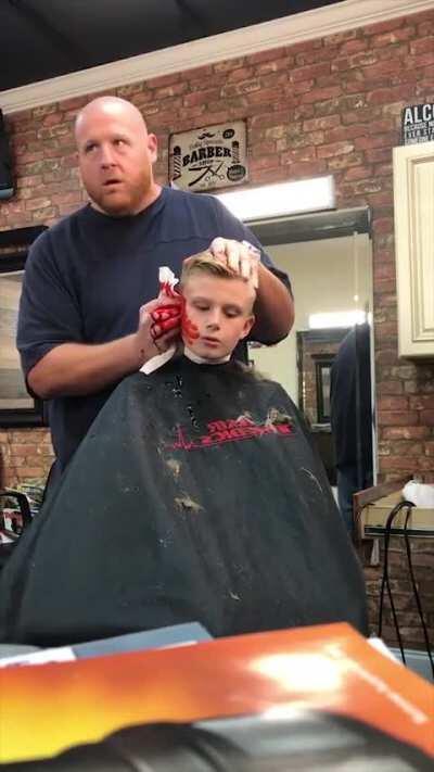 This kid is never getting a haircut again
