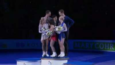 Second and third place winners lift up the first place winner to give him prominence. Cute!