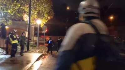 Antifa militant who ignored multiple, loud warnings to stop trespassing on government property is tackled directly into a large puddle