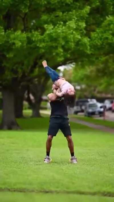 Father is a acrobat. His daughter inherited all his talent genes.