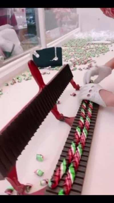 Candy being cut into pieces.