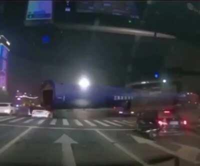Car gets dragged along by a very large pipe