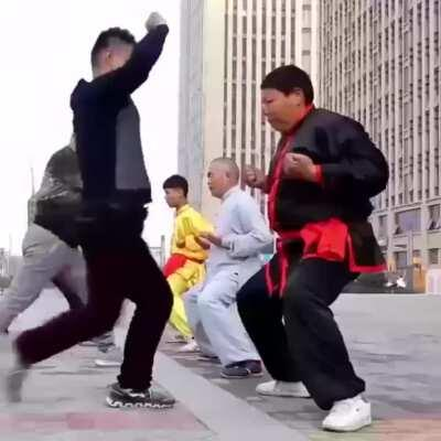 Chinese guys encourage ball destruction as part of their daily workout