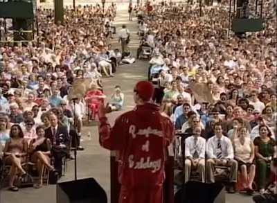 Colin Jost in the background at Ali G's 2004 Harvard commencement address