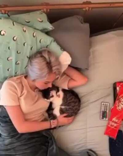 A timelapse of a lady and her cat spending a lazy day together