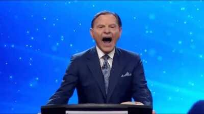 Kenneth Copeland gives a forced laugh at the election results