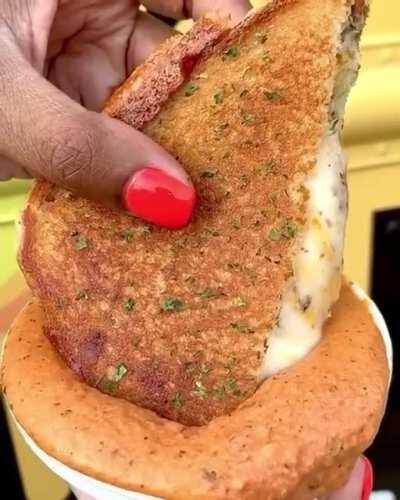 Grilled Cheese sandwich dipped in creamy tomato sauce