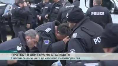 Bulgarian police uses pepper spray on protestors in front of the parliament. They forget to take the wind into account.