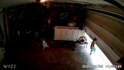 2 Year Old Takes a Garage Door Ride